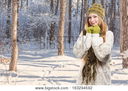 Young Stylish Smiling Blonde Woman In Variegated Melange Knitted Hat, Scarf With Fringe, Mittens And