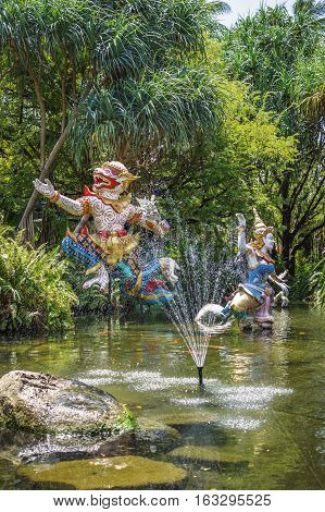 PHUKET THAILAND - CIRCA MAR 2015: Mythological characters adorn the artificial pond. In Thailand you can see a lot of bright and lovingly made heroes of the epic