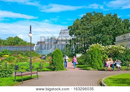 SAINT-PETERSBURG, RUSSIA, AUGUST 3, 2016: People rest in Peter the Great Botanical Garden (Botanic Gardens of the Komarov Botanical Institute of of the Russian Academy of Sciences)