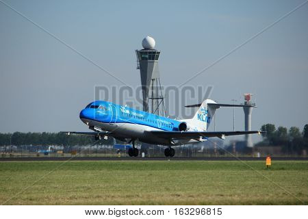 Amsterdam the Netherlands - August 18th 2016: PH-KZU KLM Cityhopper Fokker F70 taking off from Polderbaan Runway Amsterdam Airport Schiphol