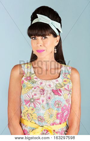 Grinning Mature Woman In Floral Patterned Dress