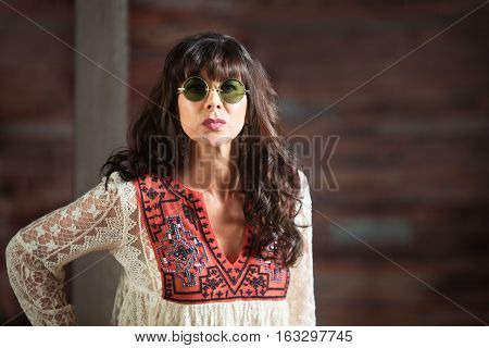 Serious Beautiful Woman In Round Sunglasses