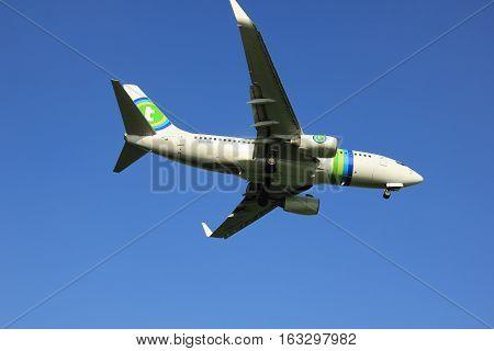 Amsterdam the Netherlands - May 6th 2016: PH-XRZ Transavia Boeing 737 approaching Schiphol Zwanenburg runway 18C arriving from Naples Italy