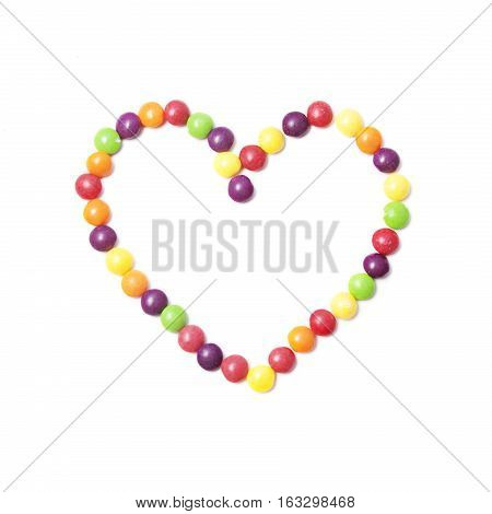 eart of colorful small rounded candies on white background