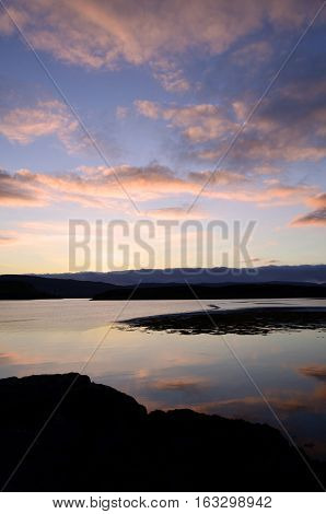 Gorgeous skies and clouds over Loch Dunvegan in Scotland.