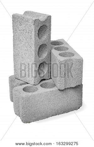 Concrete hollow blocks construction on a white background