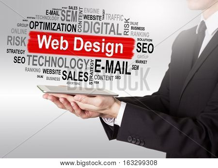 Web Design concept, young man holding a tablet computer.