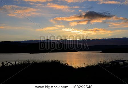 The sun rising over Loch Dunvegan in Scotland on the Isle of Skye.