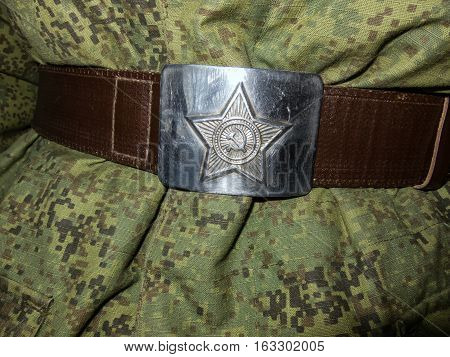 Buckle soldier's belt with a star. Close-up.