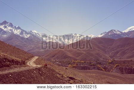 Mountain landscape with road running through wasteland. Annapurna circuit trek.