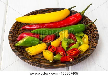 Colorful mix of the freshest and hottest chili peppers. Studio Photo