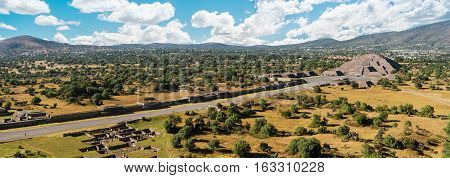 Aerial panorama of Avenue of the Dead and Pyramid of the Moon in Teotihuacan on a sunny day near Mexico City Mexico.