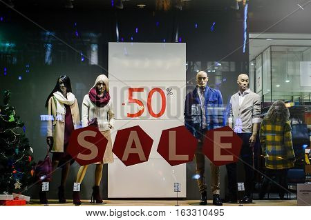 Kiev Ukraine - Dec 28, 2016:  mannequins standing in the shop window Display casual clothing store in the Mall. Clearance sale discounts up to 50%