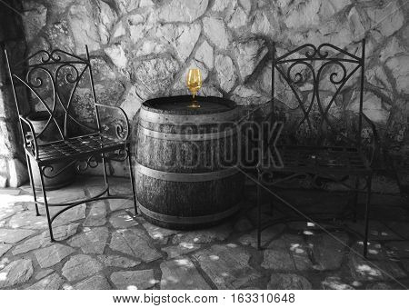 This a photo of a wine glass and barrel.