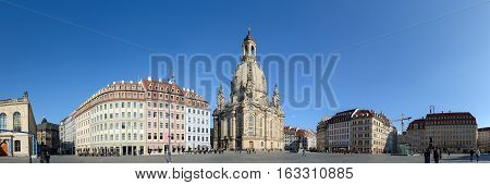 DRESDEN, GERMANY - FEBRUARY 25: People are walking on Neumarkt Square while winter morning sun is illuminating buildings of northern side of it on February 25, 2015 in Dresden, Saxony, Germany.