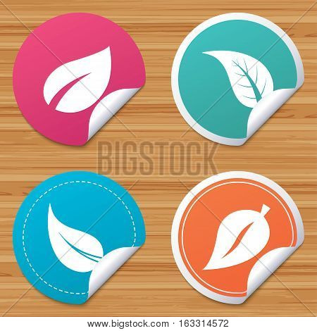 Round stickers or website banners. Leaf icon. Fresh natural product symbols. Tree leaves signs. Circle badges with bended corner. Vector