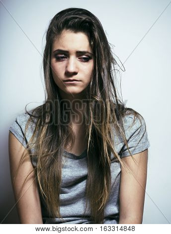 problem depressioned teenage with messed hair and sad face, real junky bad looking girl close up lifestyle