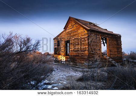 Old abandoned house near Fallon Nevada at Sunset.