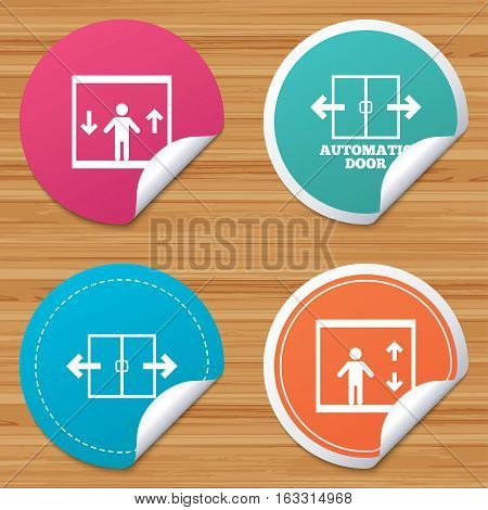 Round stickers or website banners. Automatic door icons. Elevator symbols. Auto open. Person symbol with up and down arrows. Circle badges with bended corner. Vector