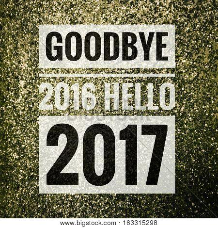 Goodbye 2016 hello 2017 words on shiny green glitter background