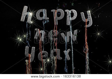 Happy New Year text with silver glitter words party lettering streamers stars and dazzling fireworks. Ideal poster, banner, greeting card or invitation image etc.