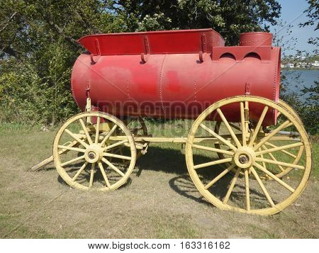 A water wagon used in the early 1900 hundreds to provide  water for steam powered tractors. May of been pulled by steam  tractors or horses.