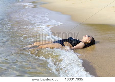 Lady relax on wave swimsuit in Ban Krut Beach at Prachuap Khirikhun Province Thailand