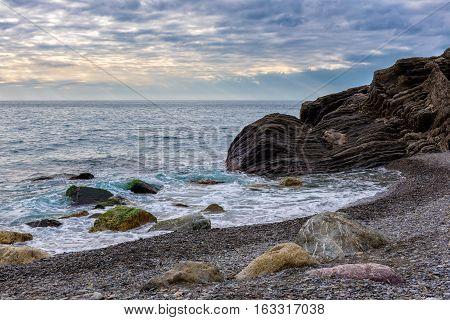 Beautiful sunset coastline of Mediterranean sea near Vernazza town in Liguria, Italy