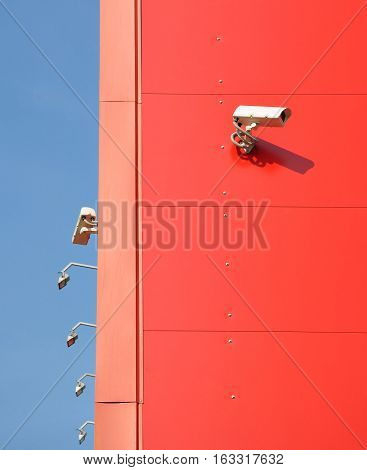 Video surveillance on the perimeter of the building. The red wall of the building