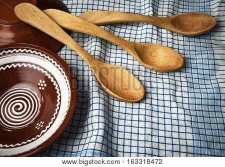 background traditional Slovak wooden spoon and a clay bowl