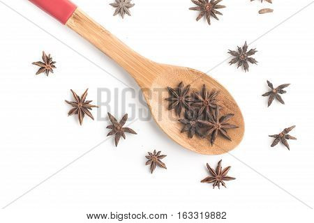 Anise Star into a spoon isolated on white background