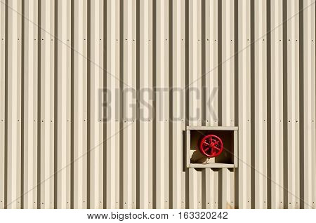 Red Water Valve on Metal Building for Background
