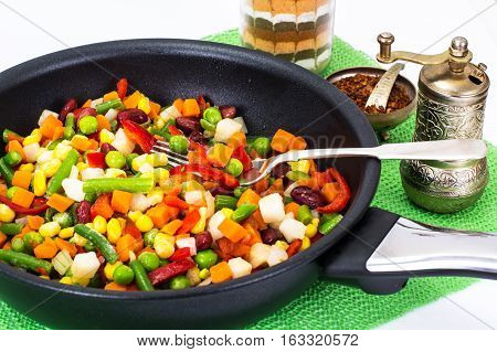 Mexican mixture of vegetables, cooked in a frying pan. Studio Photo