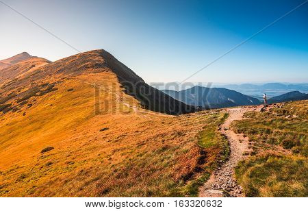 Tourist Hiking Trail in the Mountains on Sunny Day. Low Tatras Ridge, Slovakia.