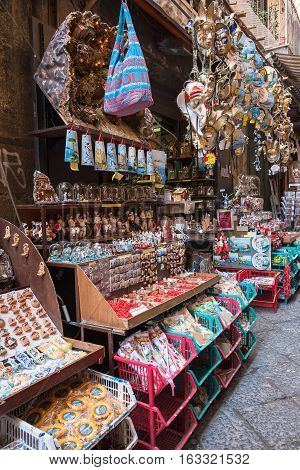 Naples Italy - August 30 2016: Traditional souvenir stall on the narrow street of Naples.