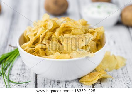 Portion Of Potato Chips With Sour Cream Taste On Wooden Background (selective Focus)