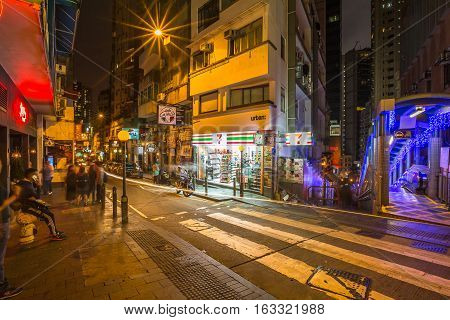 Hong Kong, China - December 10, 2016: Eleven mini market in Elgin Street by night, popular road Soho district in Central Hong Kong, famous for bars, restaurants, clubs and nightlife.