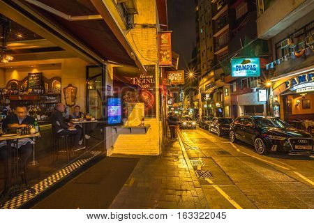 Hong Kong, China - December 10, 2016: La Pampa Argentinian Steak House in Elgin Street by night, popular road Soho district in Central Hong Kong, famous for bars, restaurants, clubs and nightlife.