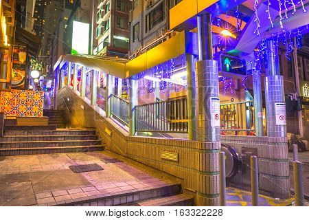 Hong Kong, China - December 10, 2016: the Central-Mid-Levels escalator, the longest outdoor covered escalator system in the world, Central Hong Kong, by night.