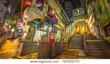 Hong Kong, China - December 10, 2016: Panorama cityscape of Central-Mid-Levels escalator and Santorini Greek Restaurant in Elgin and Shelley St, Soho district, famous for bars, restaurants, nightlife.