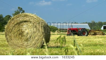 Hay Bale And Tractor