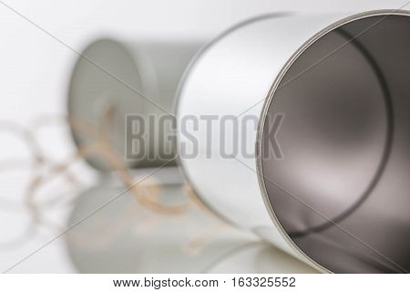 Tin cans telephone on a white background