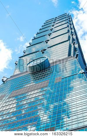 Taipei, Taiwan - 22 Feb : Business concept for real estate and corporate construction:Looking up view of Taipei 101 the landmark of Taiwan reflect blue sky and sun lights at 22 Feb 2014