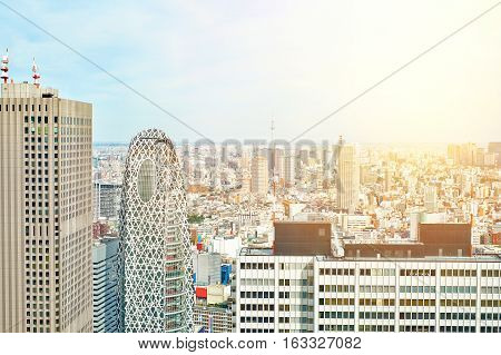Asia Business concept for real estate and corporate construction - panoramic modern cityscape building bird eye aerial view of cocoon tower and skytree under sunrise and morning blue bright sky in Tokyo Japan