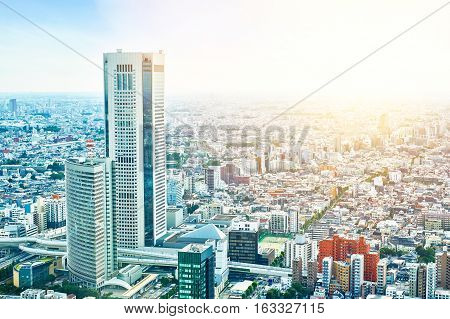Asia Business concept for real estate and corporate construction - panoramic modern cityscape building bird eye aerial view under sunrise and morning blue bright sky in Tokyo Japan