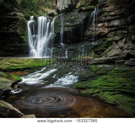 BLACKWATER FALLS STATE PARK, WV/USA - JUNE 30, 2016: A long exposure of Elakala Falls as seen on June 30 in Blackwater Falls State Park. Elakala Falls are known for their swirling pools of water.