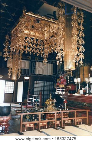 A large golden chandelier lights the interior of the Narita-san Shinshō-ji Shingon Buddhist temple in Narita, Japan.