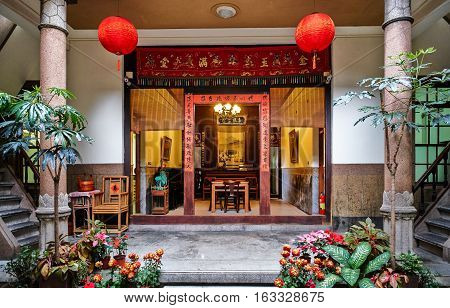 Xiluo, Taiwan - Mar. 12 : Traditional oriental chinese heritage building with spring couplets&red lantern in Taiwan (Chinese Translation on board : home full of wealth and blessing) at Mar. 12, 2016