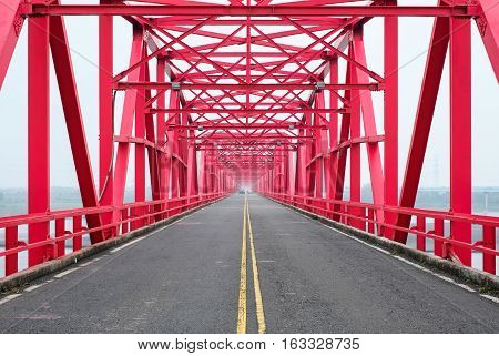 Symmetrical red steel structure construction of bridge and road in Xiluo Taiwan