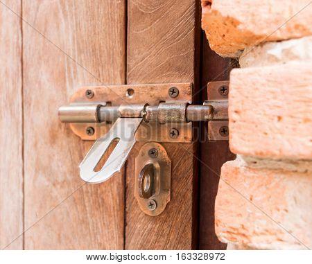 old metal brown wooden unlocked door for design